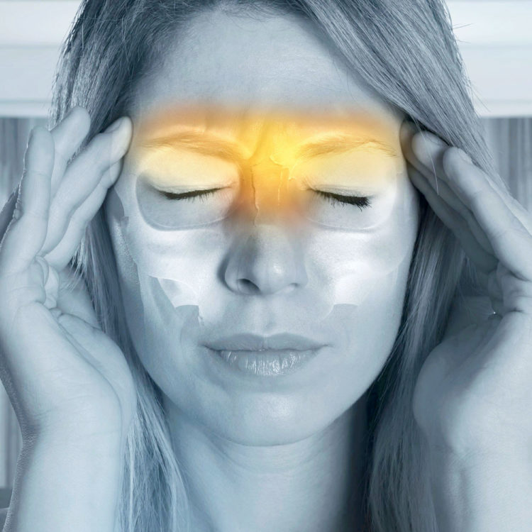 A patient suffering with headaches and migraines. Treatments are available from Tom Claykens at Biddenden Chiropractic.