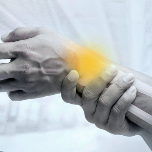 A patient suffering with joint restrictions. Treatments are available from Tom Claykens at Biddenden Chiropractic.