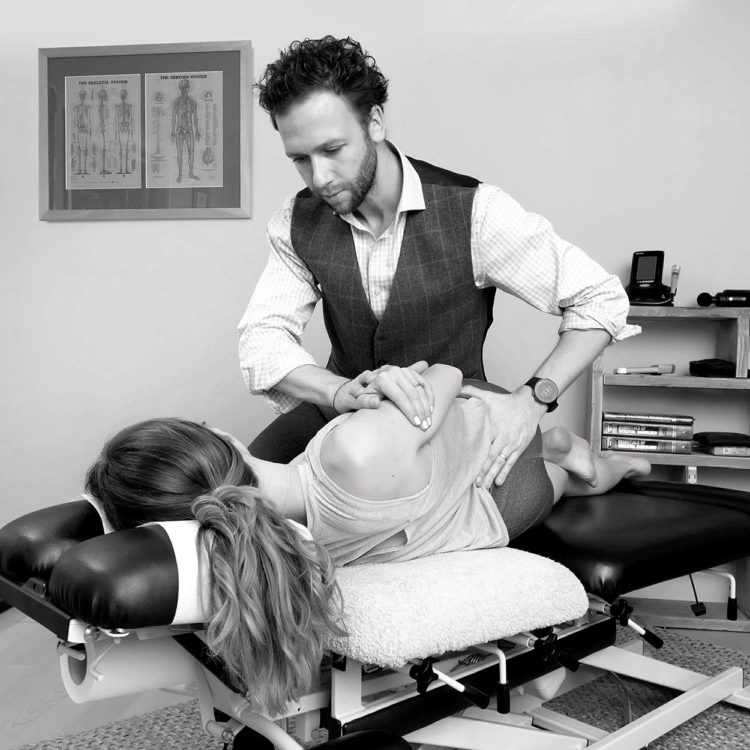 Tom Claykens treating a patient at Biddenden Chiropractic. We offer a range of treatments for back, shoulder, knee and neck pain.
