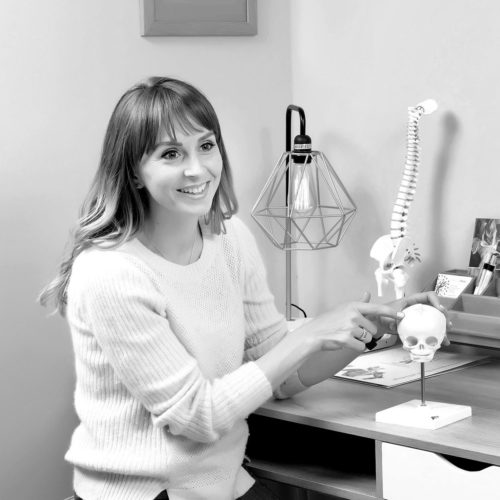 Rebecca Oliver consulting a patient at Biddenden Chiropractic. We offer a range of treatments for back, shoulder, knee and neck pain.