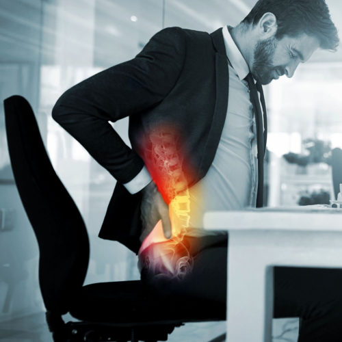 A patient suffering with back pain. Treatments are available from Tom Claykens at Biddenden Chiropractic.